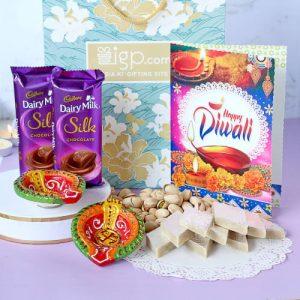 p clay diya set with kaju katli pistachios greeting card m