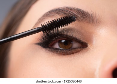 closeup eye makeup applying maskara nw